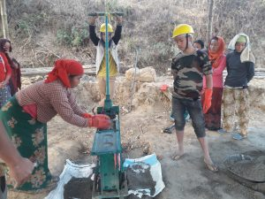 a women working to make a CSEB brick at gorkha bhusalgaun